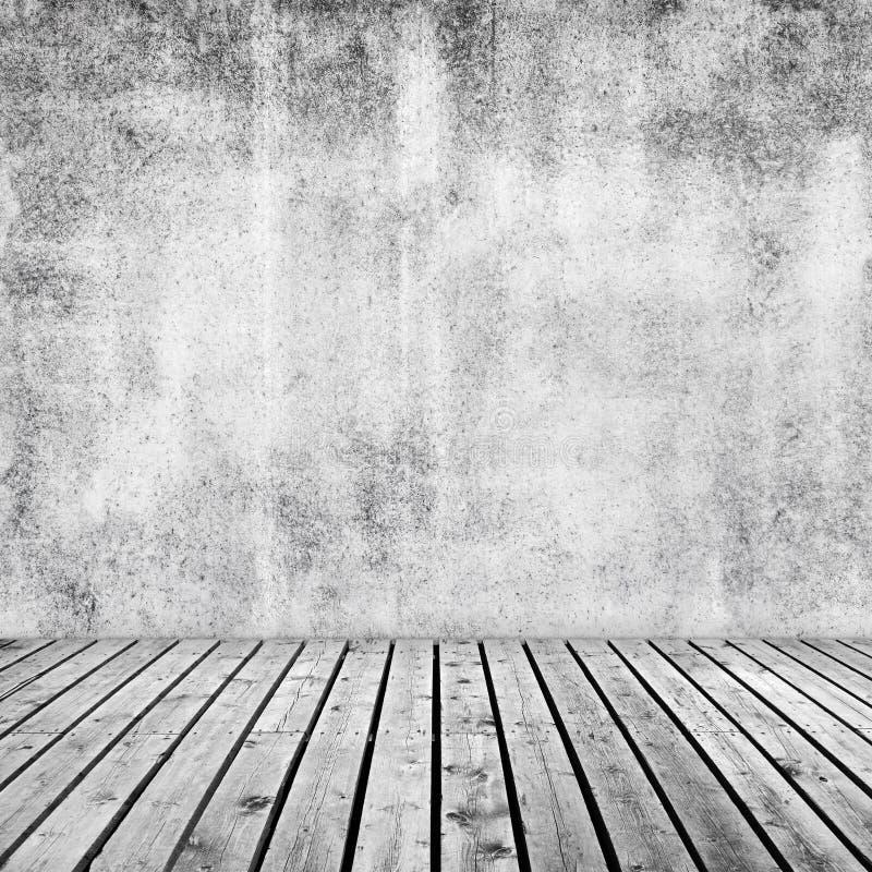 与白色混凝土墙的空的内部背景 免版税库存图片