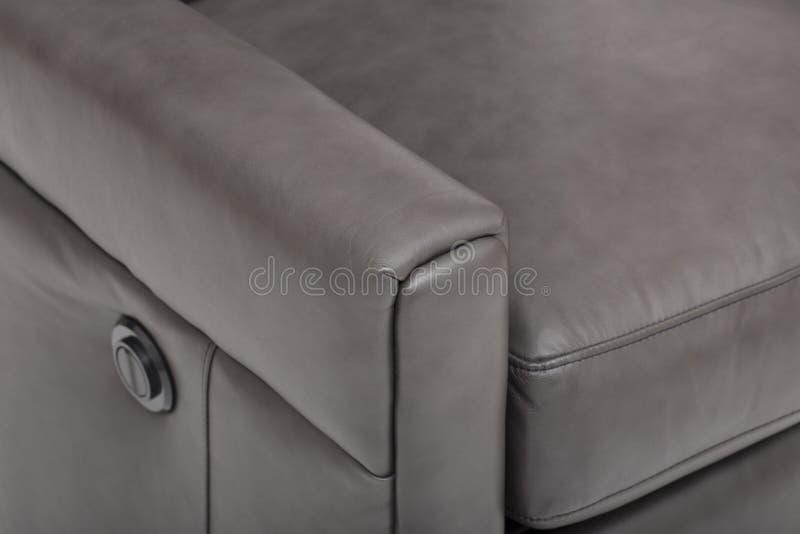 与白色背景影像的力量皮革可躺式椅椅子 库存照片
