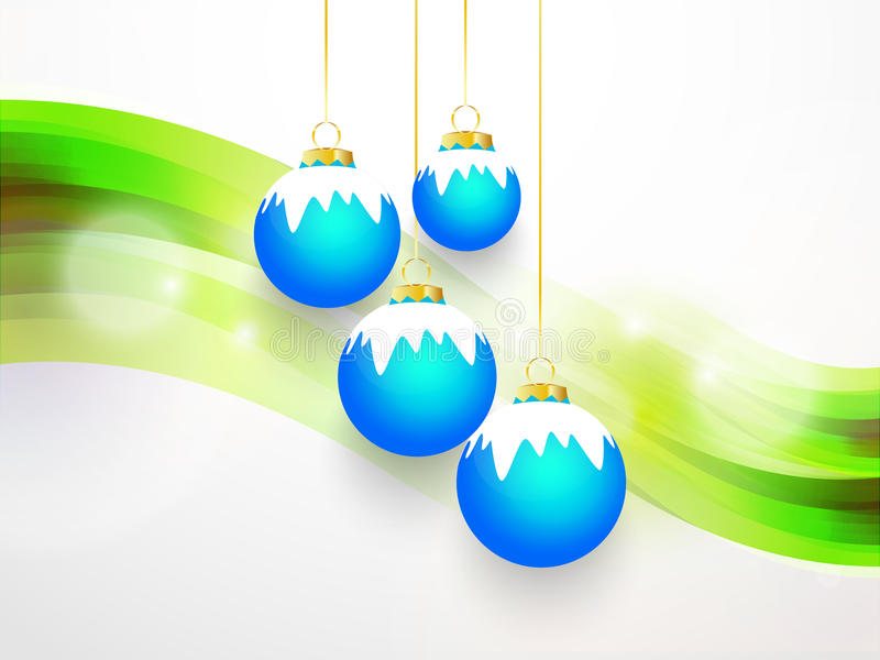 与白色雪和绿色背景的蓝色响铃 图库摄影