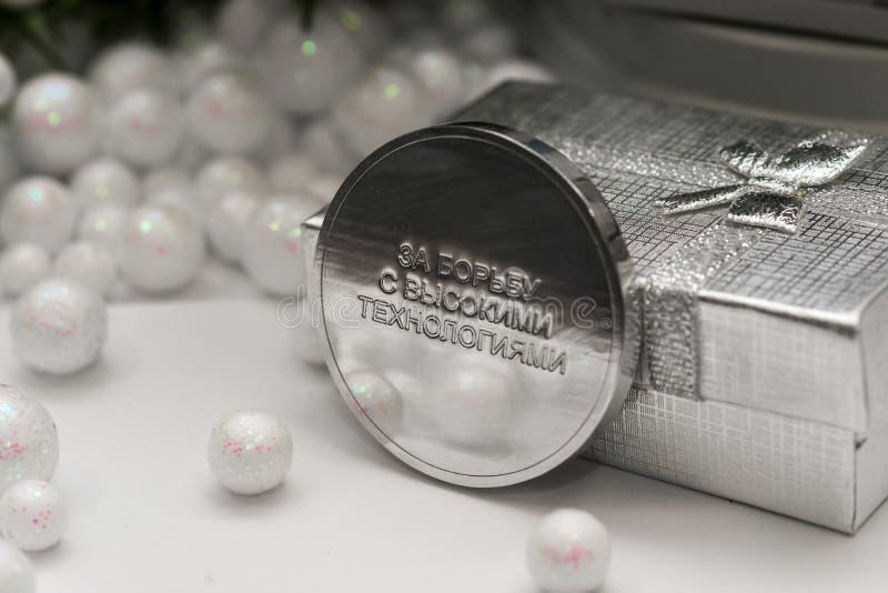 与的高技术`俄语战斗一可笑的奖牌` 图库摄影
