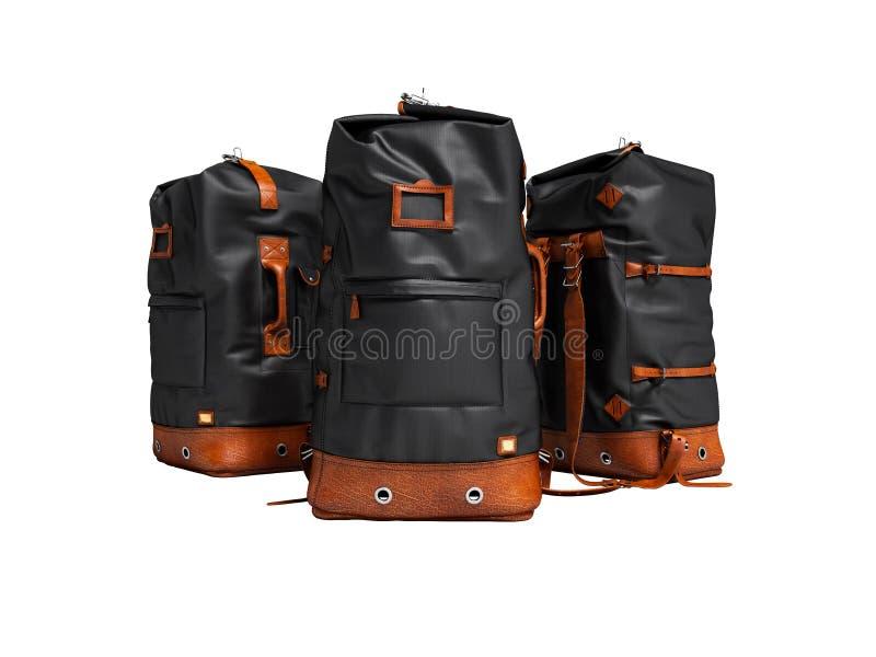 与皮革插入物的三个远足的黑袋子为周末 库存例证