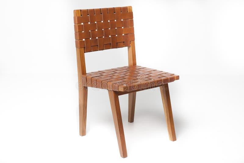 与皮革的柚木树椅子 图库摄影