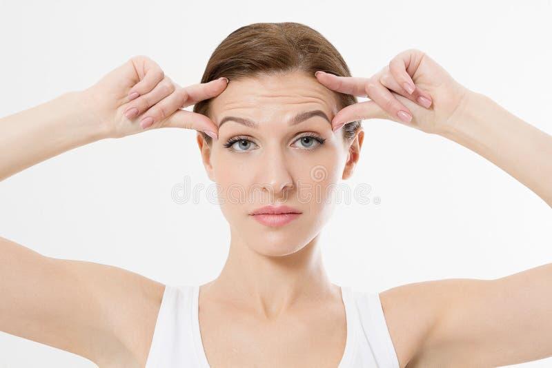 与皱痕的宏观妇女面孔在前额 胶原和面孔射入概念 应用关心皮肤透明油漆 播种的图象 复制空间 免版税库存图片