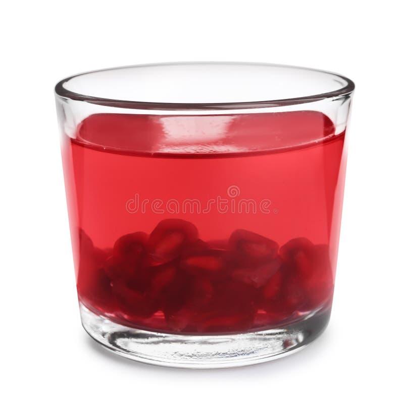 与石榴种子的鲜美果冻点心在白色的玻璃 免版税图库摄影