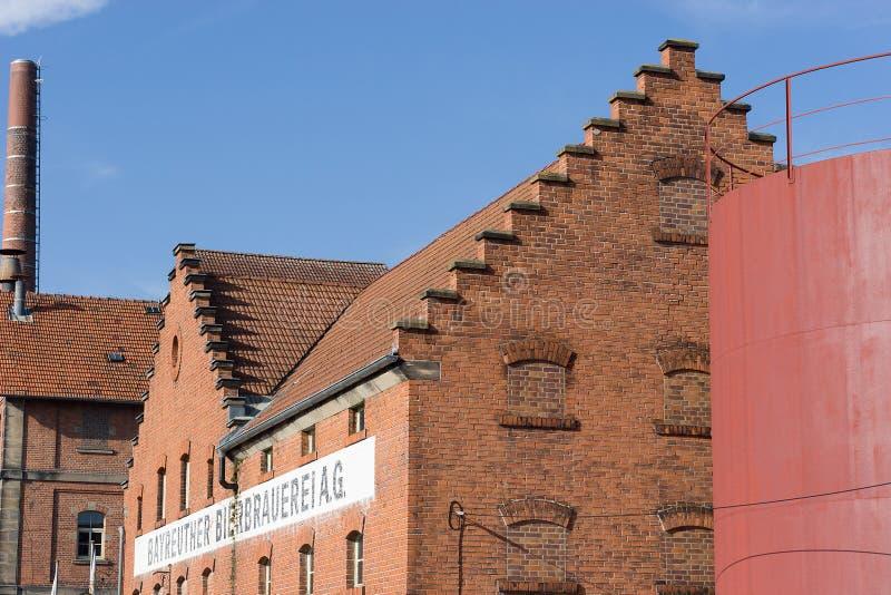 与砖石工-历史啤酒厂的大厦 库存照片