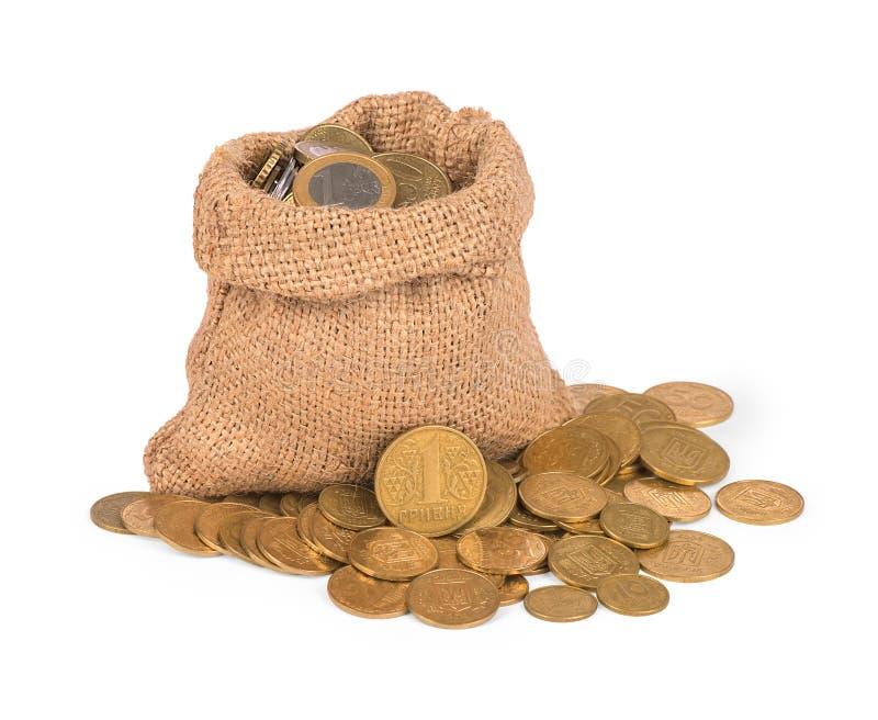 与硬币的袋子 库存照片