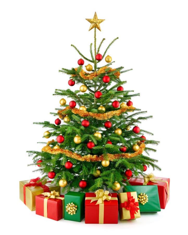 与礼物盒的华美的圣诞树 库存照片