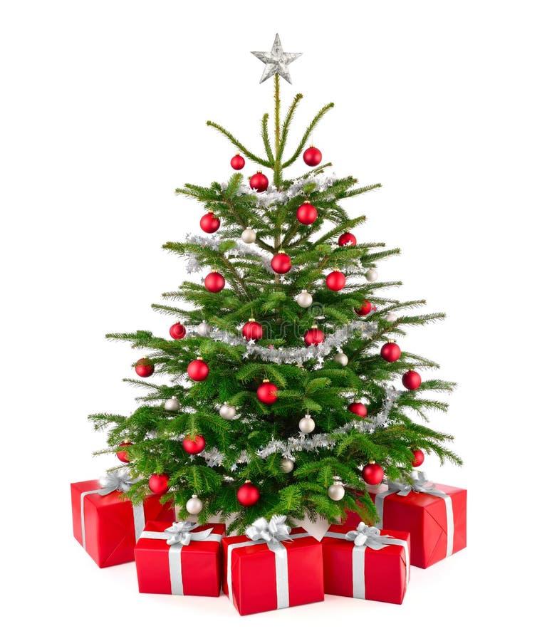 与礼物盒的华美的圣诞树 免版税库存照片