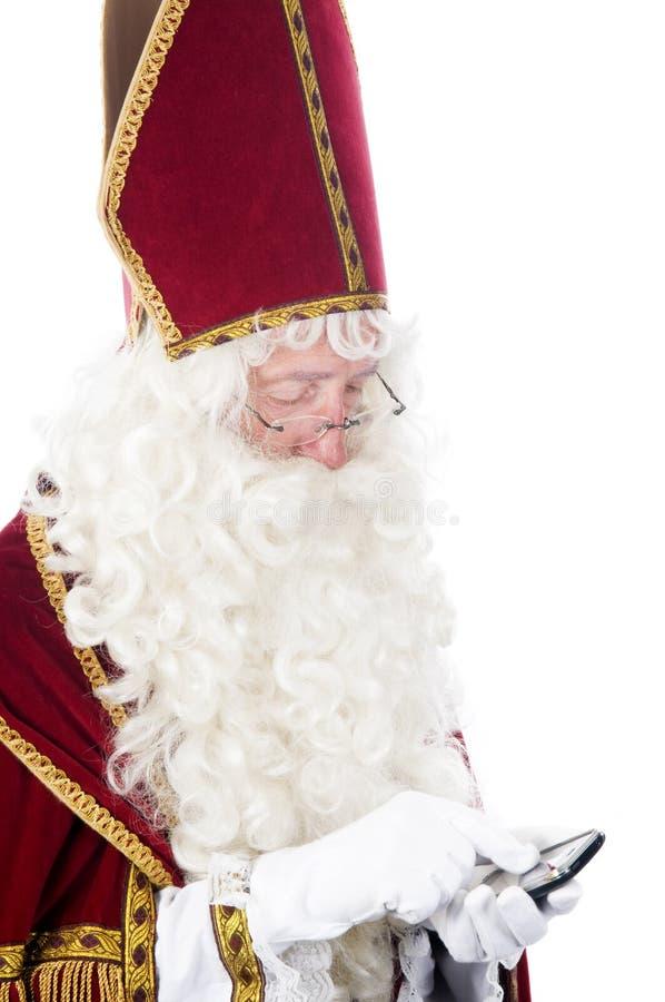 与移动电话的Sinterklaas 免版税库存图片