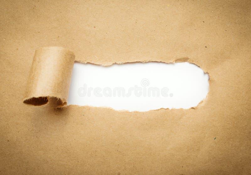 与空白的被撕毁的包装纸 库存照片