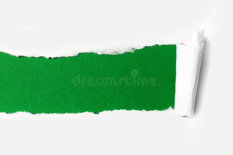与空间的被撕毁的纸有白色背景。 免版税库存图片