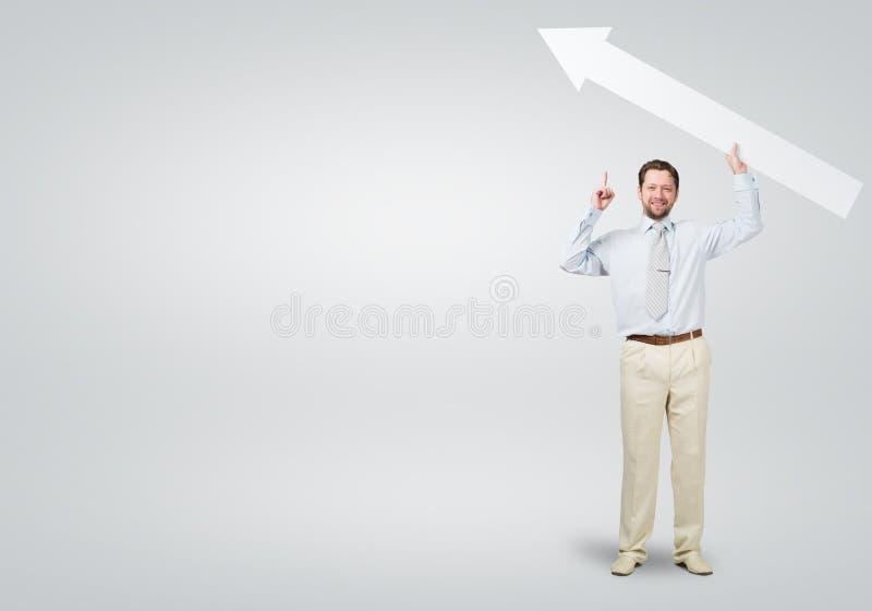与箭头的商人 免版税图库摄影