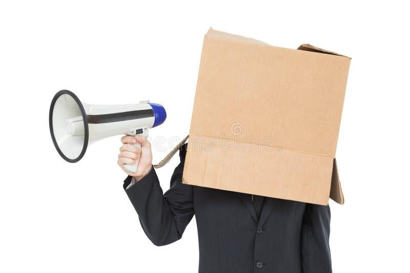 与箱子的商人在顶头举行的扩音机 库存图片