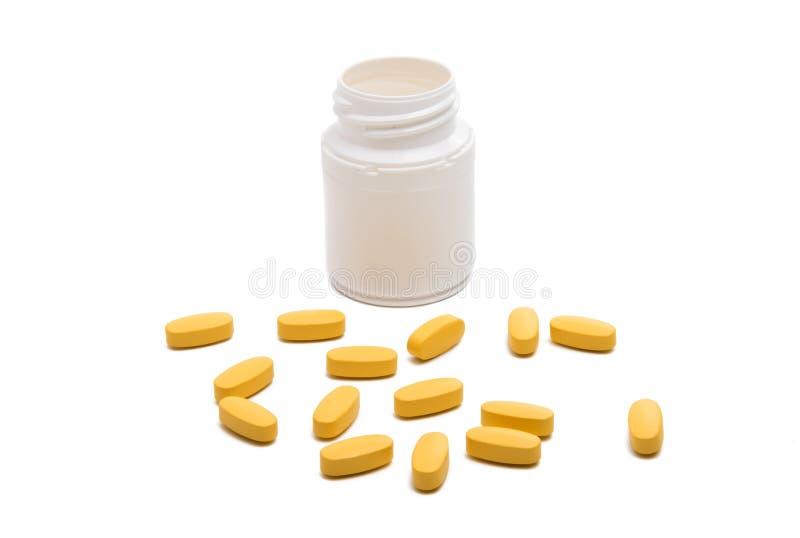 与箱子的黄色药片 图库摄影