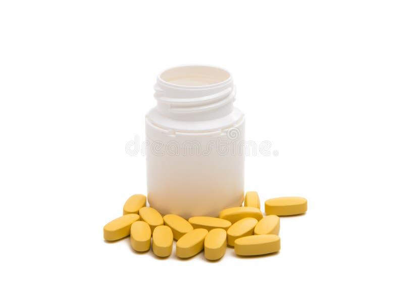 与箱子的黄色药片 免版税库存照片