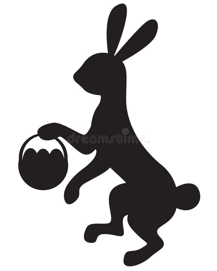 与篮子的剪影兔宝宝 库存例证