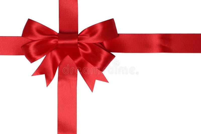 与红色丝带的礼品券礼物的在圣诞节或生日 免版税库存图片