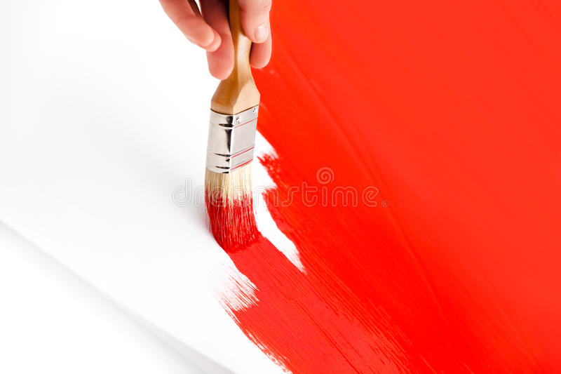 与红色墨水和画笔的绘画 库存图片