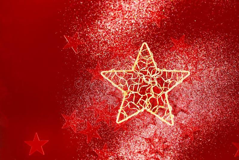 与红色小的星的圣诞节背景 免版税库存照片
