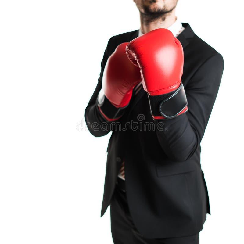 与红色拳击的商人 免版税库存照片