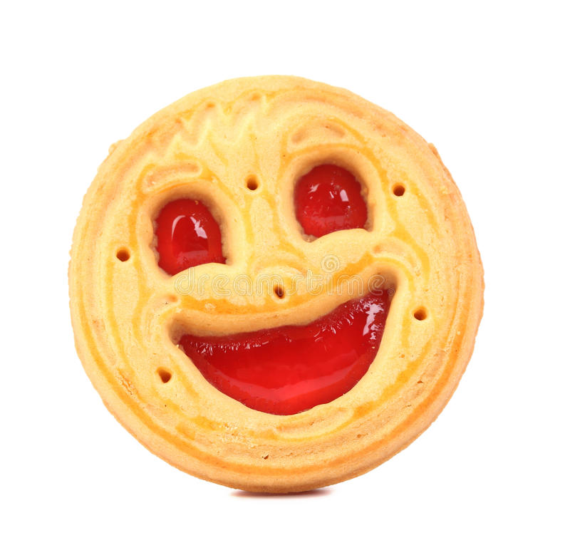 与红色果冻的微笑饼干。 库存照片