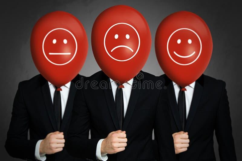 与红色气球的Businessmens 免版税库存图片