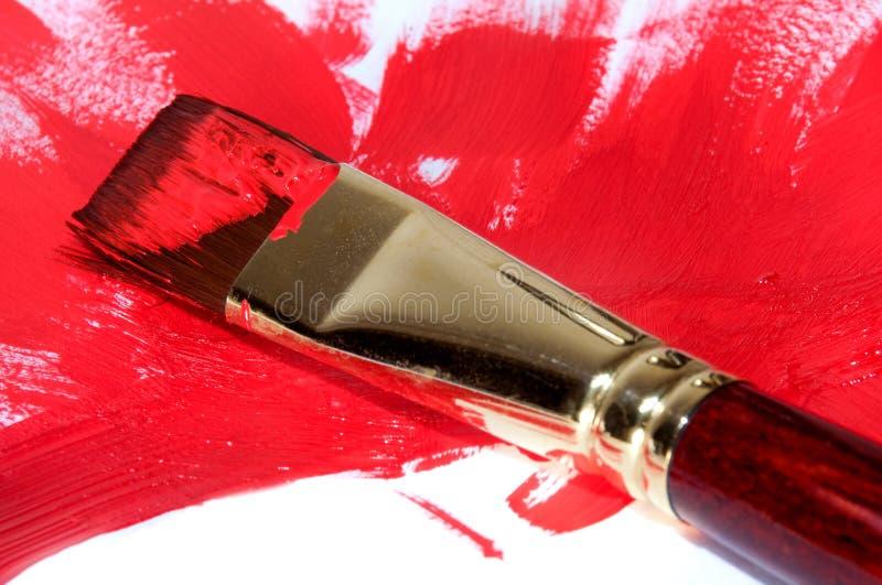 与红色的画笔绘画 库存图片