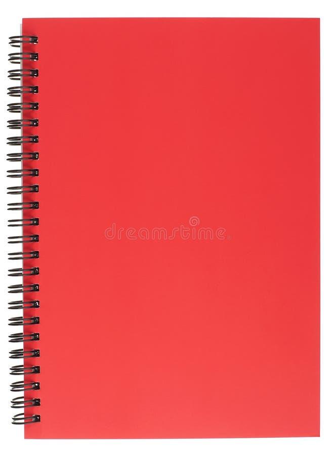 与红色盖子的螺旋装订的记事本 库存照片