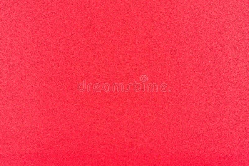 与纹理的红色黄色梯度颜色从背景、背景或者设计的真正的泡沫海绵纸 免版税库存图片