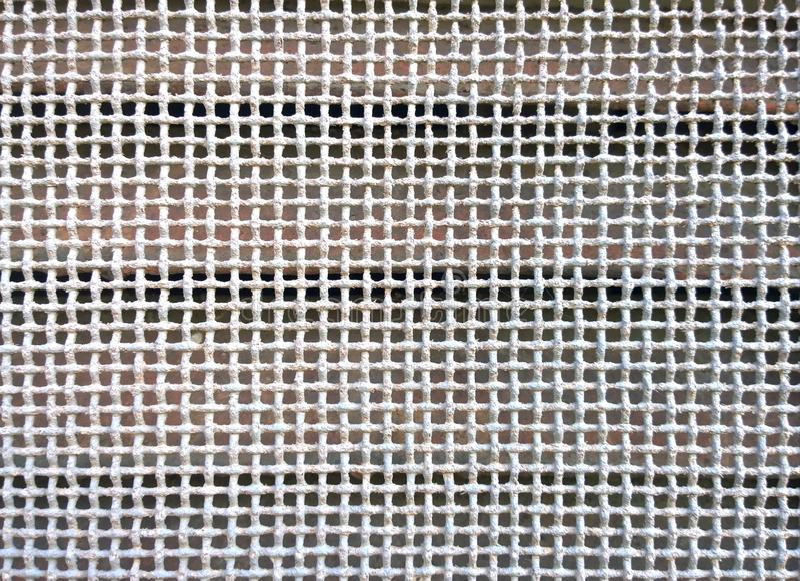 与细孔的被氧化的金属格栅 免版税库存图片