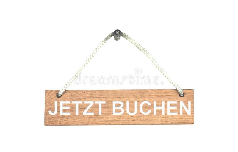 与绳索的木标志:现在书德语 免版税图库摄影