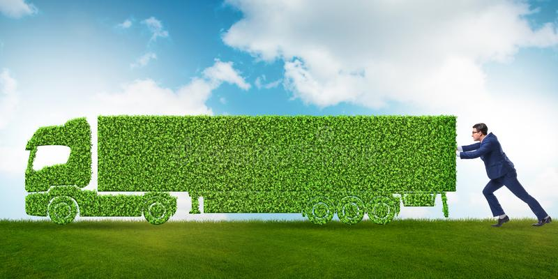 与绿色生态车的商人 免版税图库摄影