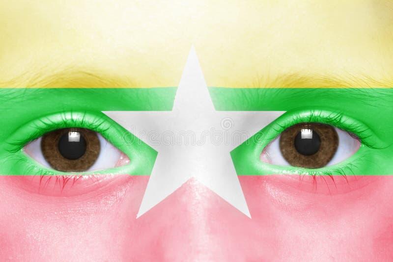 与缅甸旗子的面孔 免版税库存照片