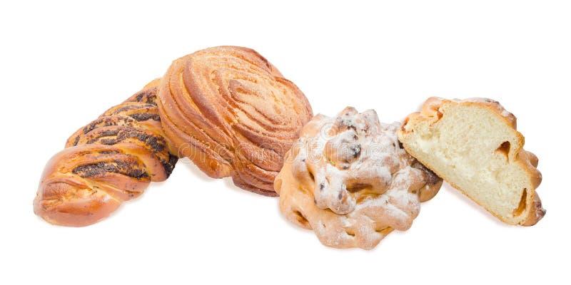 与罂粟种子、桂皮卷和小圆面包的饼用果酱 库存照片