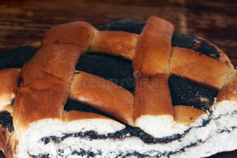 与罂粟种子的大小圆面包 甜小圆面包 库存照片