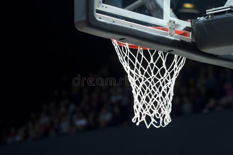 与网的篮球篮在黑背景 免版税库存照片