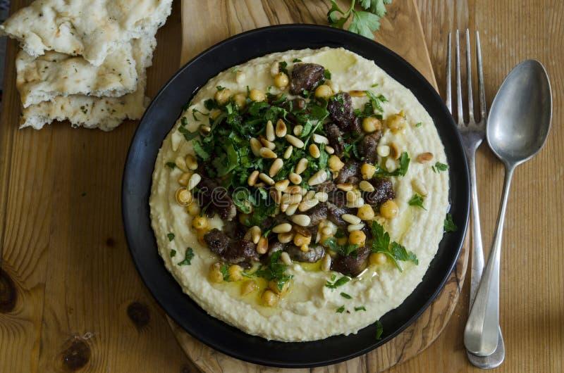 与羊羔的Hummus 免版税库存图片