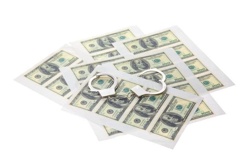 与美元和手铐的打印的板料 图库摄影