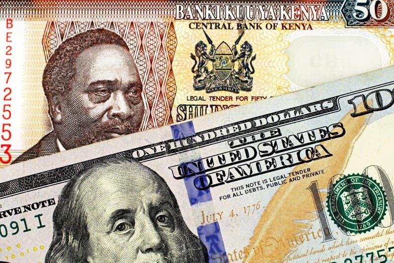 与美国一百元钞票的肯尼亚五十先令钞票 图库摄影