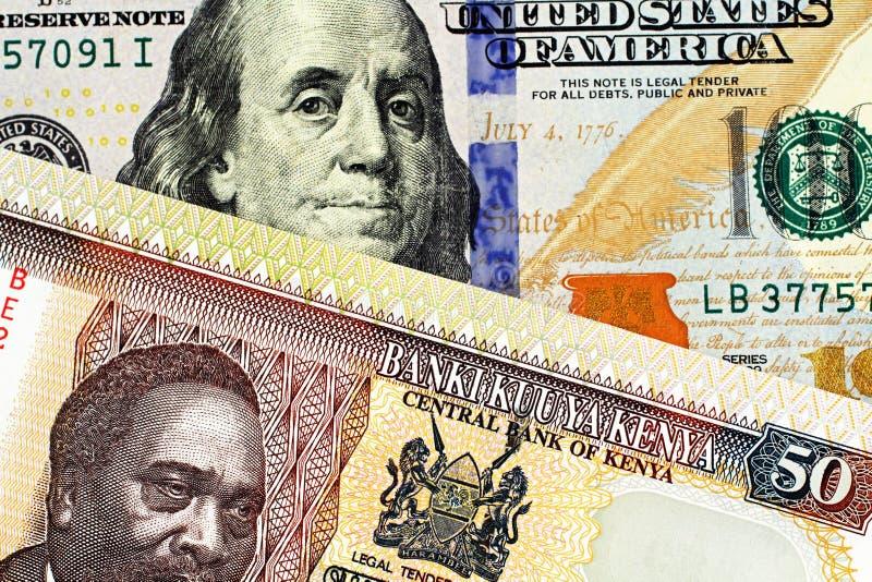 与美国一百元钞票的肯尼亚五十先令钞票 库存照片