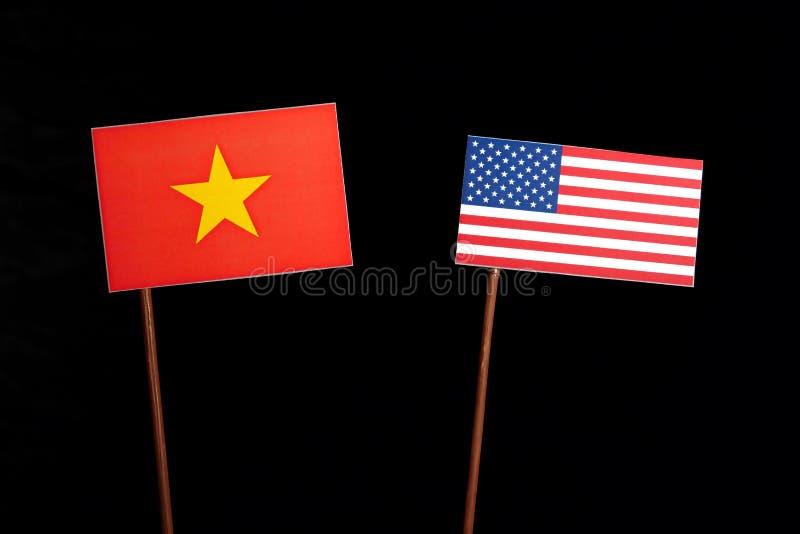 与美国旗子的越南旗子在黑色 库存照片