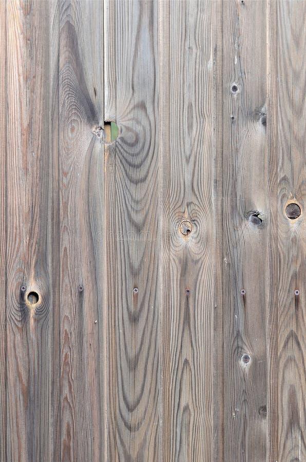 与美好的抽象五谷表面纹理、垂直的镶边背景或者背景的老难看的东西黑褐色木盘区样式 库存图片