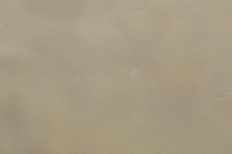 与老黄斑的轻的米黄纸背景 免版税图库摄影