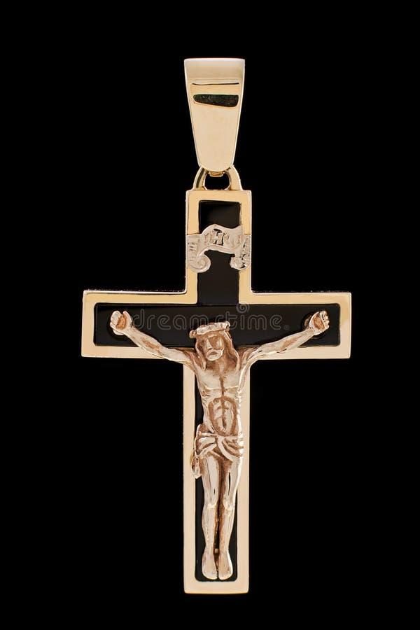 与耶稣受难象的金发怒垂饰 免版税图库摄影