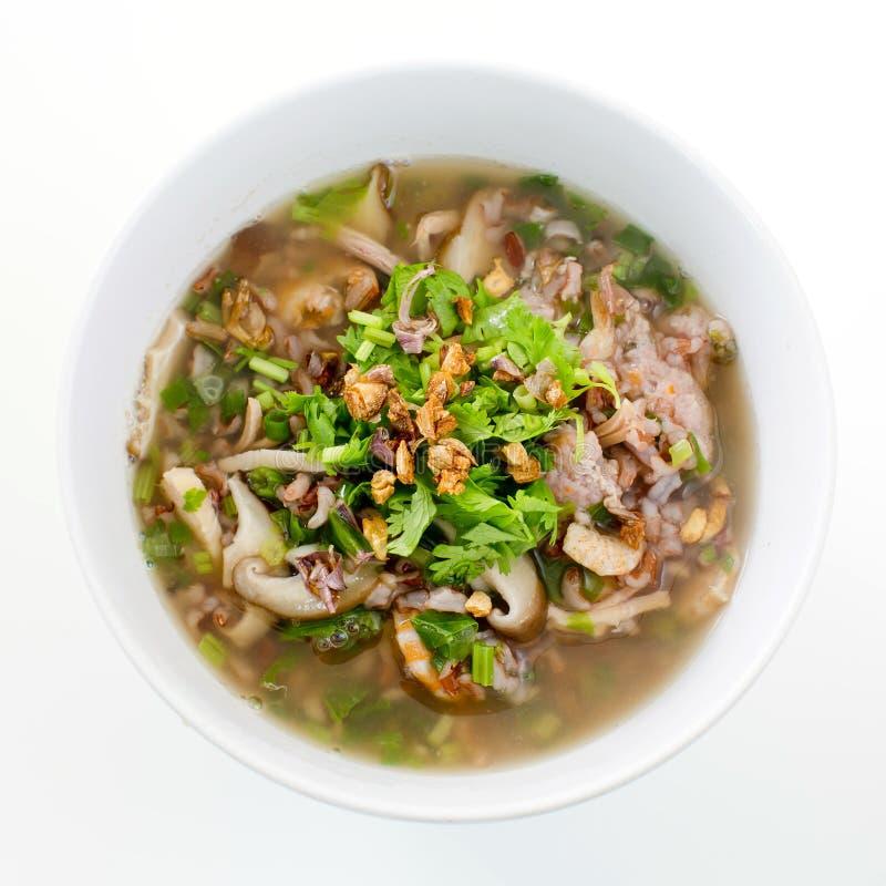 与肉或米稀饭混合的米鞠躬用猪肉烘干了shrim 库存图片