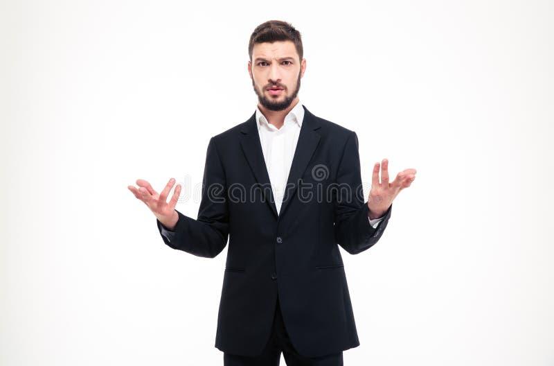 与胡子的英俊的困惑的商人在两只手中的拿着copyspace 免版税库存图片