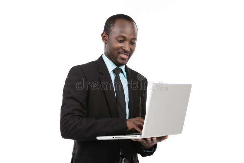 与膝上型计算机的商人 免版税库存图片