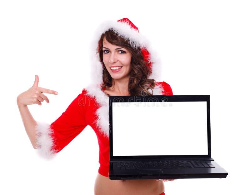 与膝上型计算机的性感的错过圣诞老人 库存照片