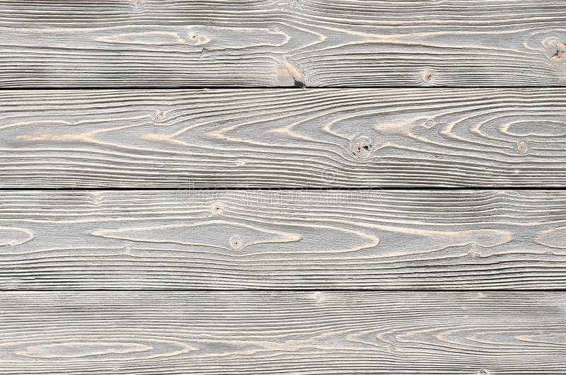 与自然条纹图形的灰色木纹理背景的 免版税库存图片