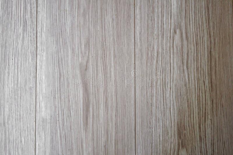 与自然样式的木纹理 层压制品的镶花地板 作为背景,木纹理的轻的软的木表面 木板条 免版税库存照片